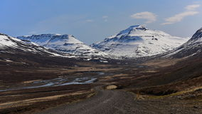 Road leading to the snow mountain in Iceland Stock Photos
