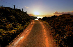 Road leading to sunset over Pembroke Coast Royalty Free Stock Images