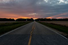 Road leading to the sunset royalty free stock image