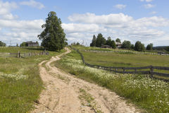 Free Road Leading To The Village Of The Russian North Stock Photos - 77650773