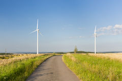 Road Leading To Wind Turbines Royalty Free Stock Images