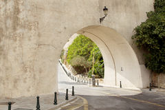 The road. Leading through the tunnel, lamp, stone grey wall, her light, day time, summer, South of the city, green trees Stock Photos