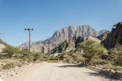 Road leading through a valley. Road through a valley in Oman Royalty Free Stock Images