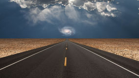 Road leads into desert toward galaxy Royalty Free Stock Photos
