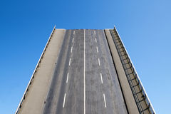 Road leads directly upwards in the blue sky, concept for future Royalty Free Stock Photo