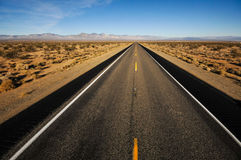 Road leads into mountains far away Royalty Free Stock Photo