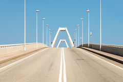 Road leads to the bascule bridge in the harbor Barcelona Royalty Free Stock Photo