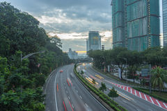 Road leads to a building and sunrise Royalty Free Stock Photography