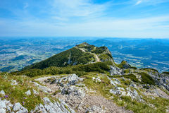 A road leads to a cross on the top of mountain landscape, Untersberg, Salzburg Stock Photos