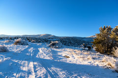 Road that leads to snow mountain, winter landscape Royalty Free Stock Photo