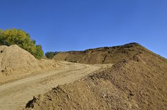 Road leads to top of a sand pile Royalty Free Stock Photos