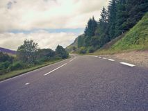 Road leaving the distance,  perspective view. European countries, Scotland. Road leaving the distance,  perspective view. Far away on the horizon is a beautiful royalty free stock photo
