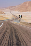 Road, leaving a zigzag in the desert Royalty Free Stock Photography