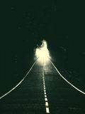 road with light at end royalty free stock images
