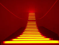 Road Light. Red beam of light in the room paved a road Royalty Free Stock Images
