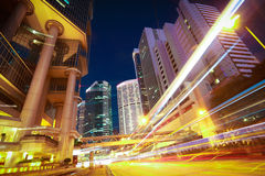 Road light trails on modern city buildings backgrounds in HongKo Stock Photos
