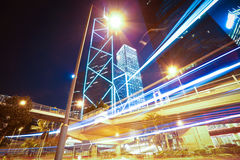Road light trails on modern city buildings backgrounds in HongKo Stock Images
