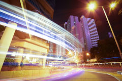 Road light trails on modern city buildings backgrounds in HongKo Royalty Free Stock Photo