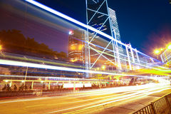 Road light trails on modern city landmark buildings in HongKong Royalty Free Stock Photos