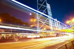 Road light trails on modern city landmark buildings in HongKong Royalty Free Stock Photos