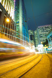 Road light trails on streetscape buildings backgrounds in HongKo Stock Images
