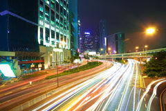 Road light trails on streetscape buildings backgrounds in HongKo Royalty Free Stock Image