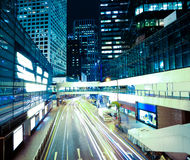 Road light trails on streetscape buildings in HongKong Stock Photography