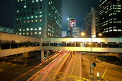 Road light trails on streetscape buildings in HongKong Royalty Free Stock Photography