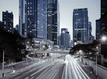 Road light trails on streetscape buildings in HongKong Royalty Free Stock Photo