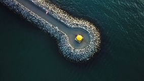Road and a lighthouse in the sea. view from above. mood aeriel video footage from the top. Road and a lighthouse in the sea. view from above. mood aeriel video stock video footage