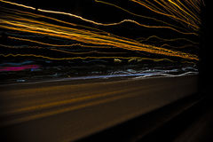 Road Lights. Lights of the passing vehicles while on the bus from Athens to Chalkis, Greece Royalty Free Stock Images