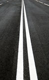 Road line. Asphalt road double line - speed path royalty free stock photos