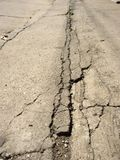 Road line. Cracking streaked cement stock image