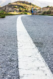 Road. Line and two mans walk together Stock Image