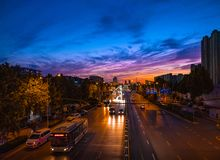 The road lined with sunset clouds stock image
