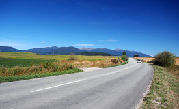 Road at Liptov and Rohace mountains. Summertime view of road in Liptov region leading to Liptovsky Mikulas town, Slovakia. Rohace mountains, part of Western royalty free stock images