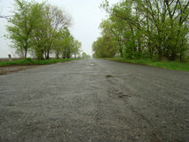 Road. Lonely asphalt road stretches into the distance in an unknown direction Stock Images
