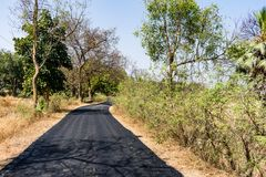 Close view of Newly made bitumen road at rural village looking awesome for village people. This road is made newly for a rural village & a lot of village people stock photos