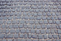 Road made of stone tiles. Abstract texture for template stock images