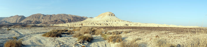 Road and Mador hill. Dirt road and Mador hill in Nehev desert in Israel Royalty Free Stock Photography