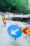 Road Maintenance. Shot of a damaged road segment in the forest Royalty Free Stock Photo