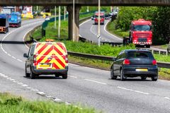 Road maintenance van on uk motorway in fast motion.  royalty free stock photo
