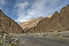 Road among majestic rugged mountains Stock Photo