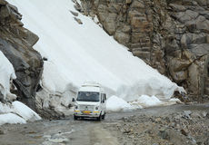 The road in Manali, Kashmir, India. The car running on snow mountain in Manali, Kashmir, India. Manali is a hill station nestled in the mountains of the Indian Royalty Free Stock Images