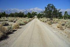 Road Through Manzanar. The main road through Manzanar National Historic Site, California (Sierra Nevada in the background Royalty Free Stock Image