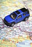 Road map. Toy car on top  road map Royalty Free Stock Photo