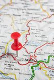 L& x27; Aquila pinned on a map of Italy. Road map of the city of L& x27; Aquila Italy stock image