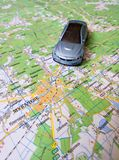 Road map and toy car on the map. A road map and a gray toy car on the map follow the route to the city Royalty Free Stock Photo