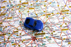 Road map of Poland with car. Blue car on map near inscription Warsaw, Poland royalty free stock photography