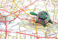 Road map with toy turtle Royalty Free Stock Photos